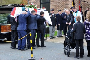 Mac coffin is carried into church